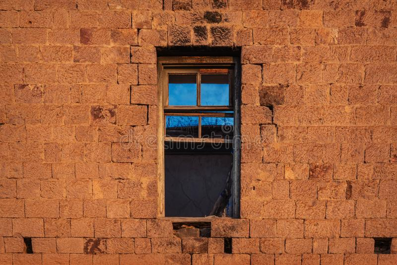 Window in old ruined abandoned house royalty free stock photo