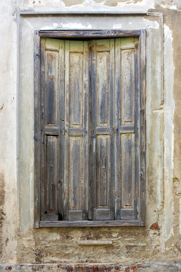 Window with old shutters. Window with aged shutters on old house in Croatia stock images