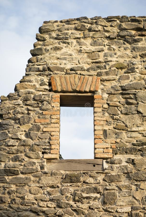 Window of an old stone wall stock photo