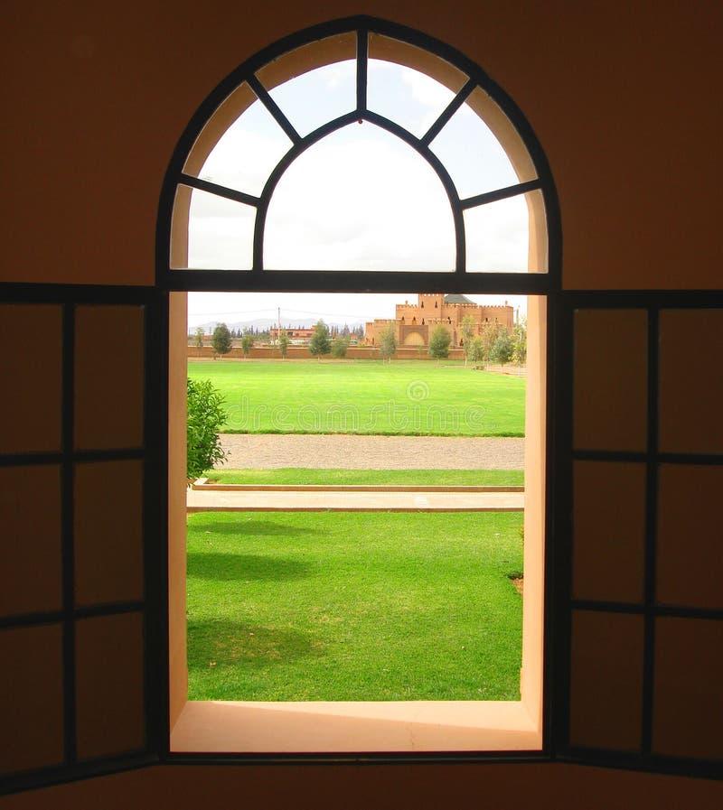 Window Open to green field. A window open to a green world outside royalty free stock photo