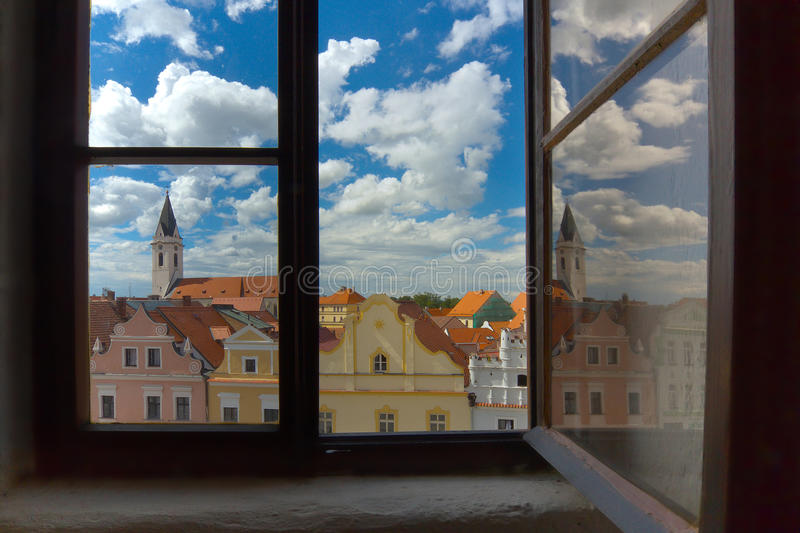 The Window. Opened window viewed to the historical town of Trebon, South Bohemia royalty free stock photography