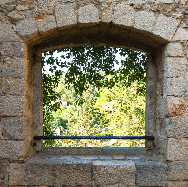 Window overlooking the garden in a brick wall. royalty free stock photo