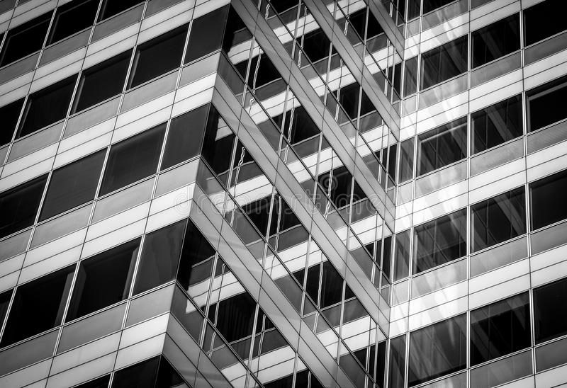 Window pattern. Abstract photo of a modern glass building with crossing lines and reflections royalty free stock photo