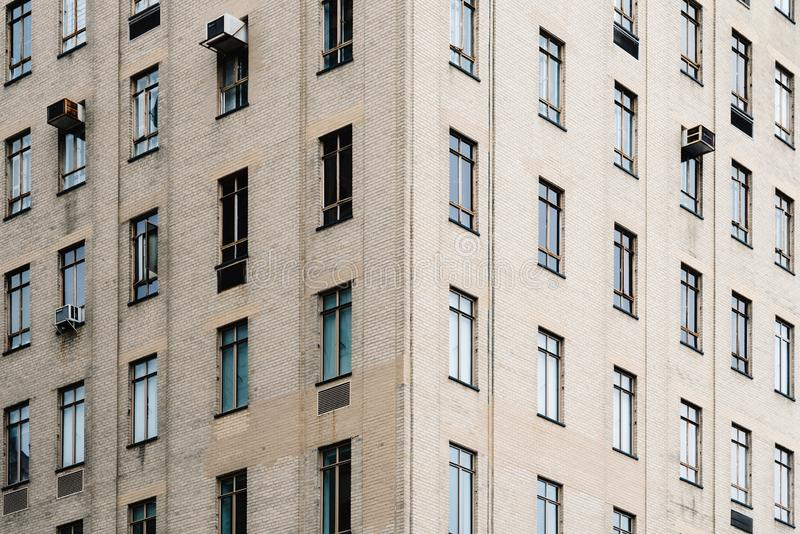 Window pattern in facade of residential buildings royalty free stock photo