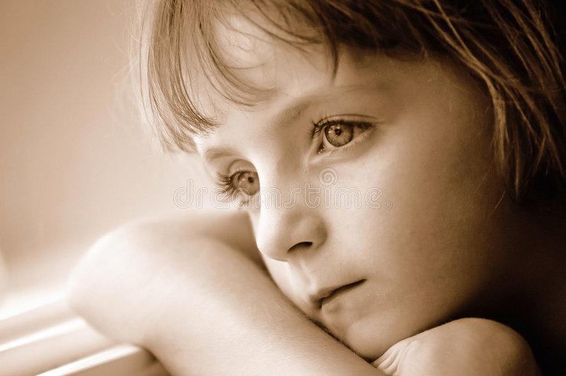 Window Portrait of Little Girl Looking Out stock photos