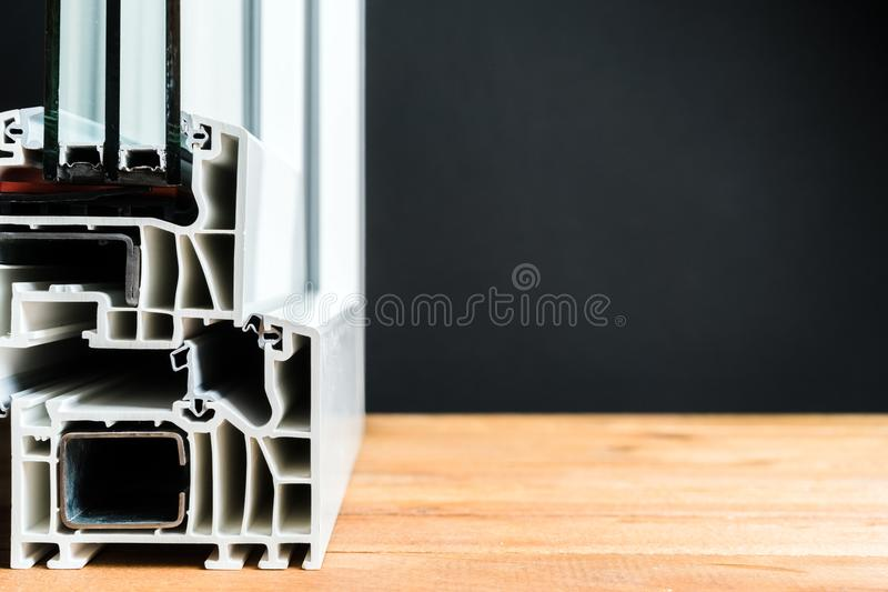 Window profile cross section, triple glazing structure, energy efficient solution, copy space.  royalty free stock photo