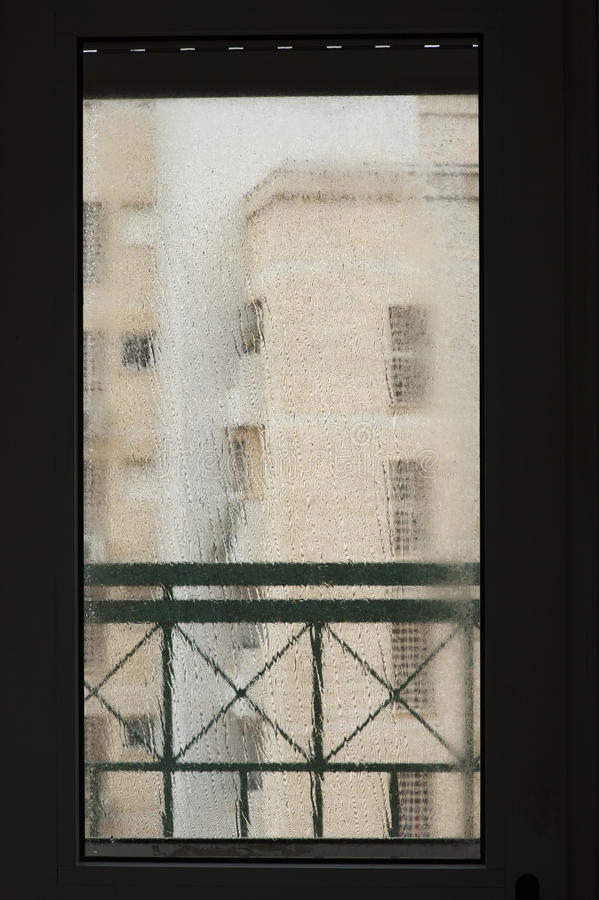 Window in an rainy day. Window with drops in an rainy day royalty free stock image