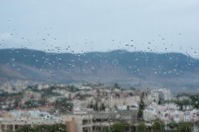 Window in an rainy day. Window with drops in an rainy day royalty free stock photos