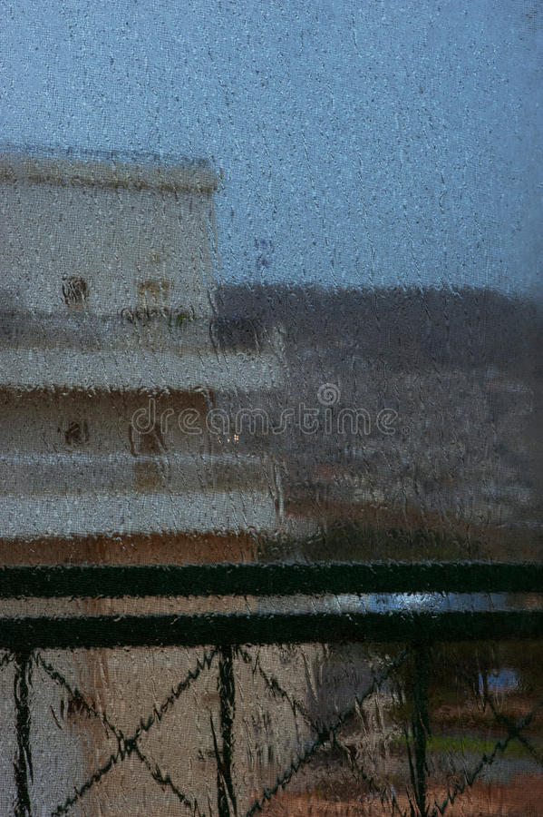 Window in an rainy day. Window with drops in an rainy day royalty free stock photography