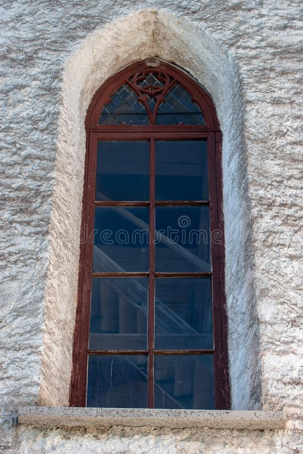 Window with a red wooden frame at the old church. stock photo