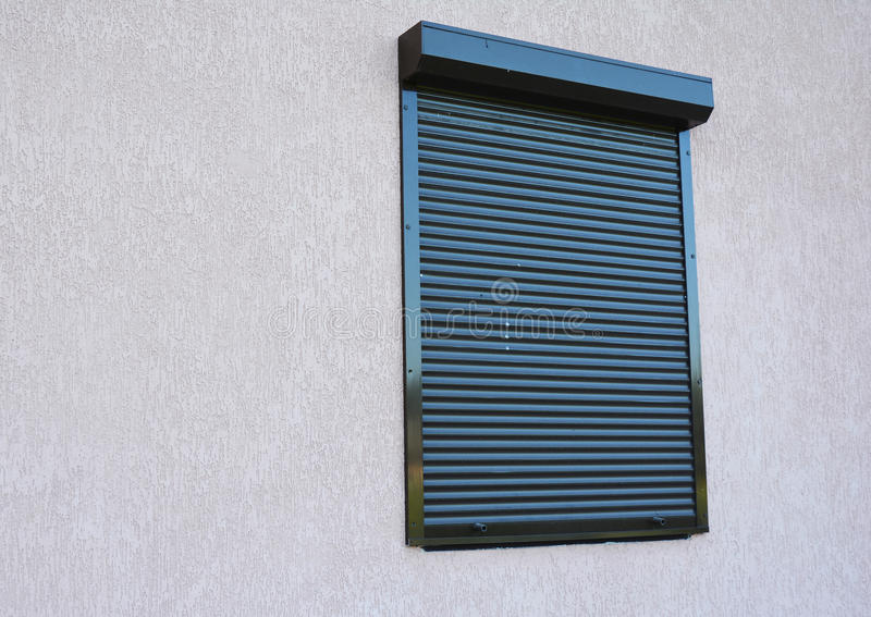 Window with rolling shutter stock photo