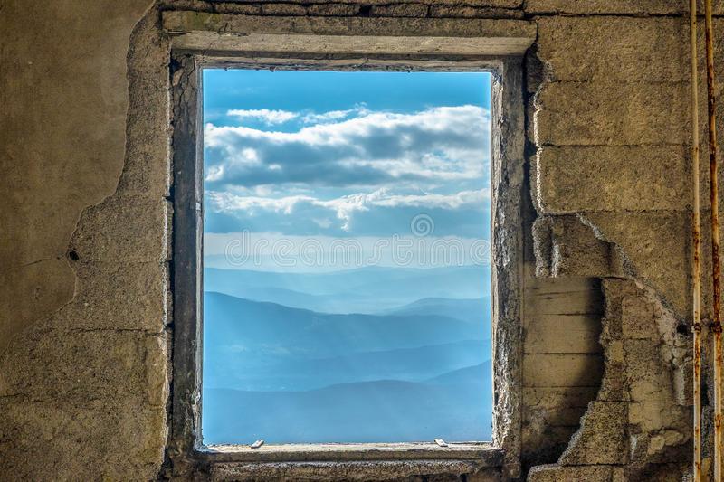 Window Scenic mountain view dramatic sky royalty free stock images