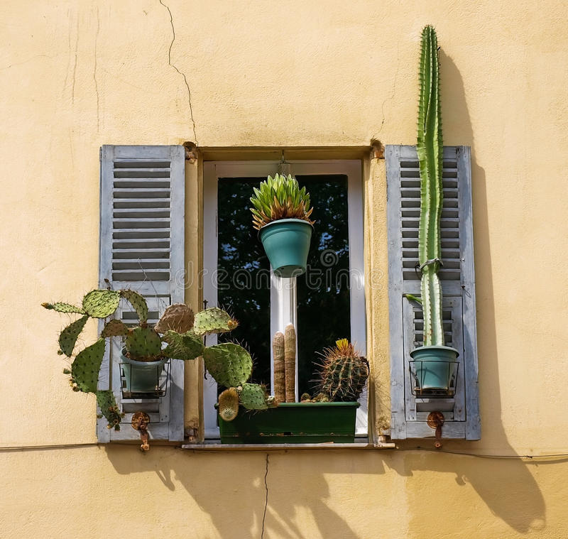 Window with shutters. Traditional French window with shutters in Nice, France royalty free stock image