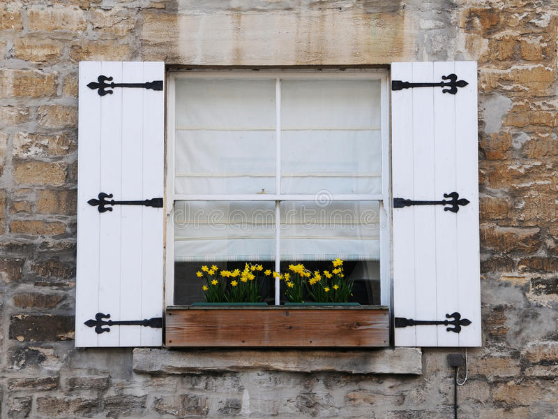 Window with Shutters. Old English Cottage Window with Shutters and Flower Box stock photo