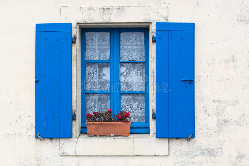 Window with shutters. Window with colorful shutters on the opal coast in northern France stock image