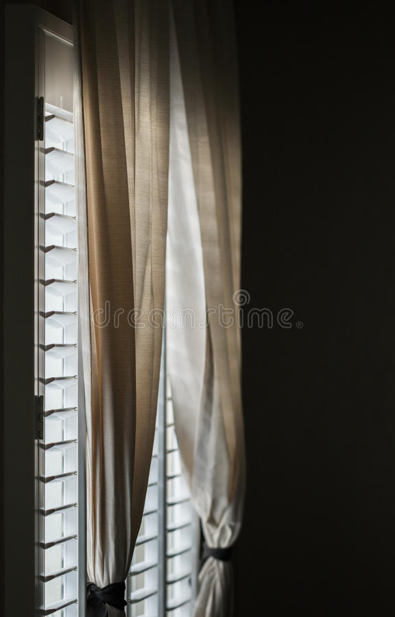 Window Shutters. In the living room stock image
