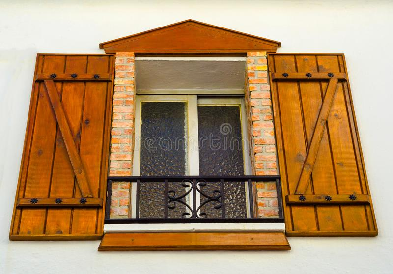 Window shutters on an old european style building for European style windows