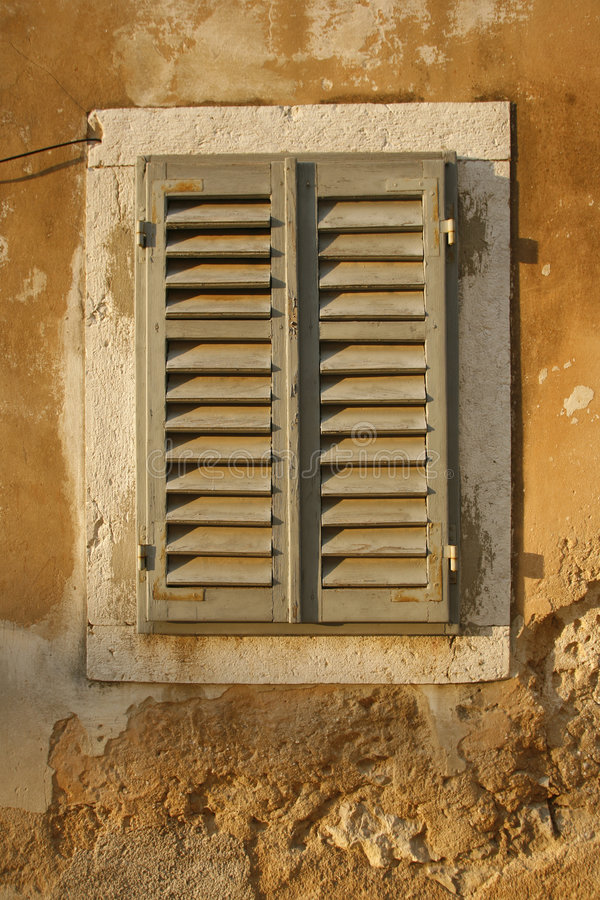 Window shutters on old house royalty free stock photography