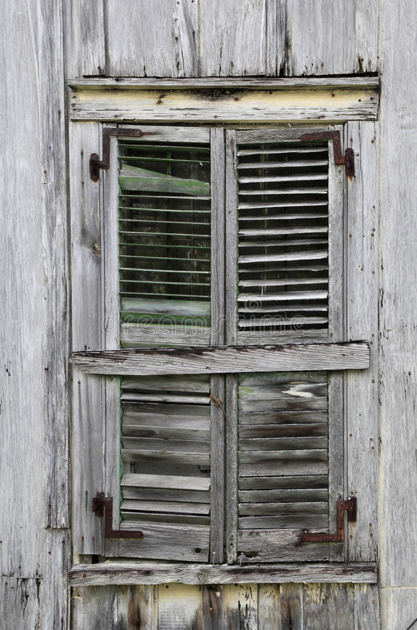 Window Shutters On Old Weathered Wooden House Royalty Free