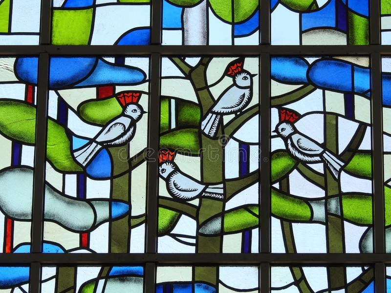 Window with stain glass birds, Lithuania stock photos