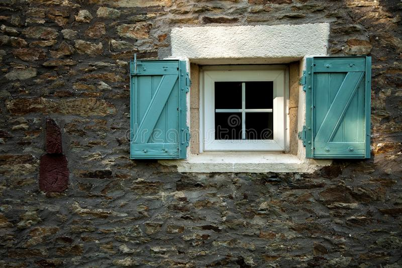 Window with shutters. Window on a stone cottage with traditional shutters royalty free stock photos