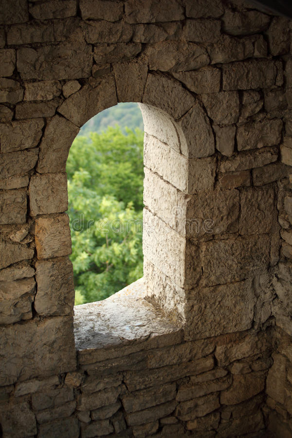 Window in stone wall royalty free stock photography