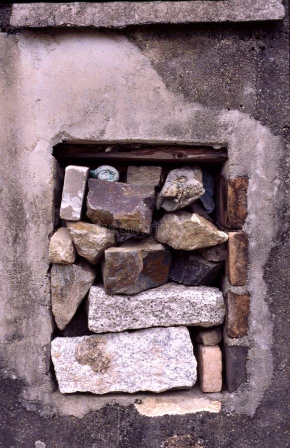 Window with stones stock photo