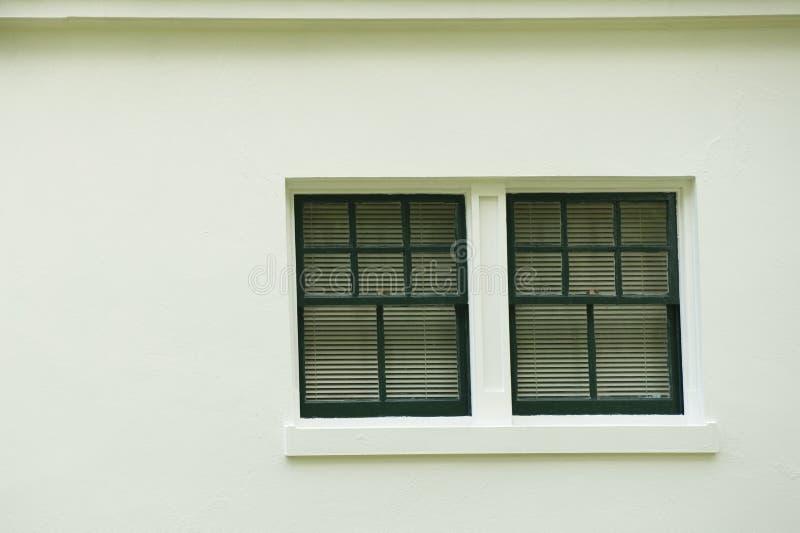 Window on Stucco building