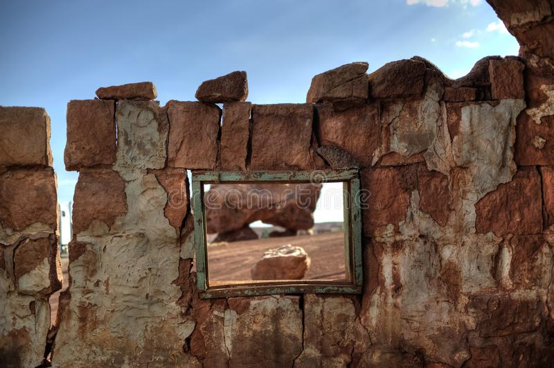 Window to the desert wilderness. Abandoned house in American South West desert stock images