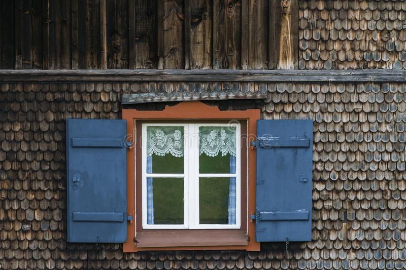 Window at a typical old bavarian farmhouse in the alps. stock photo