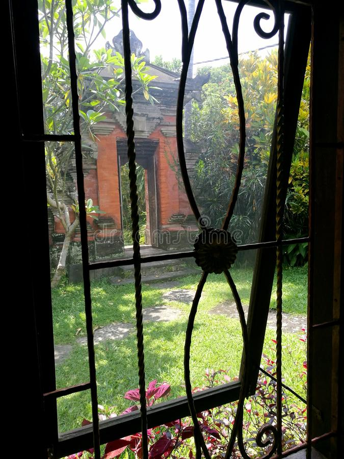 Window view of Balinese garden and side gate royalty free stock photos