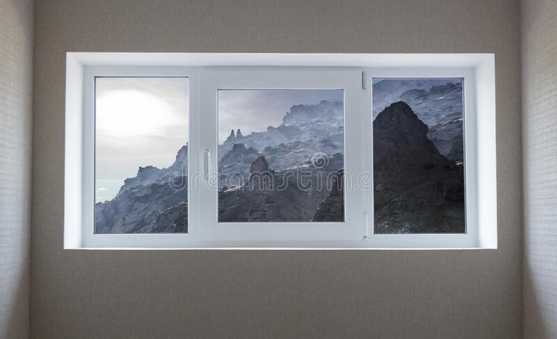 Window view of a beautiful mountain landscape royalty free stock image