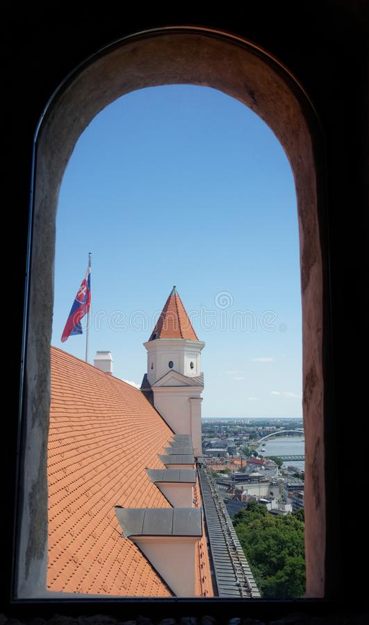 Window view of Bratislava castle roof and tower stock photo