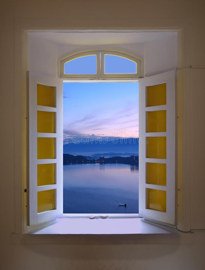 Window View of Dawn at the Sun Moon royalty free stock images