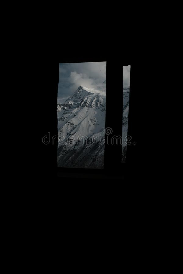 A window view from Nepal. View from our appartment during hiking in Annapurna circuit trek stock photo