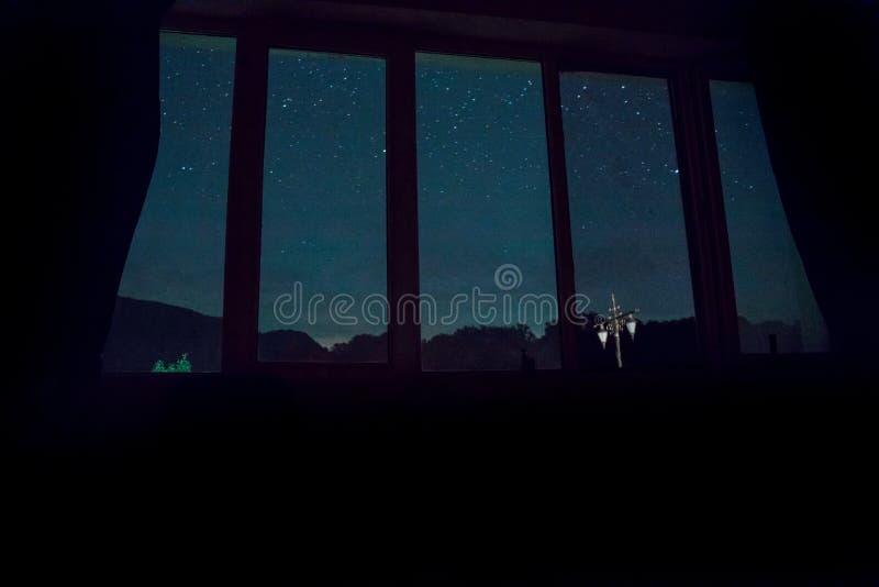 WIndow with view on night sky with stars. Dark room. WIndow with view on night sky with stars royalty free stock image