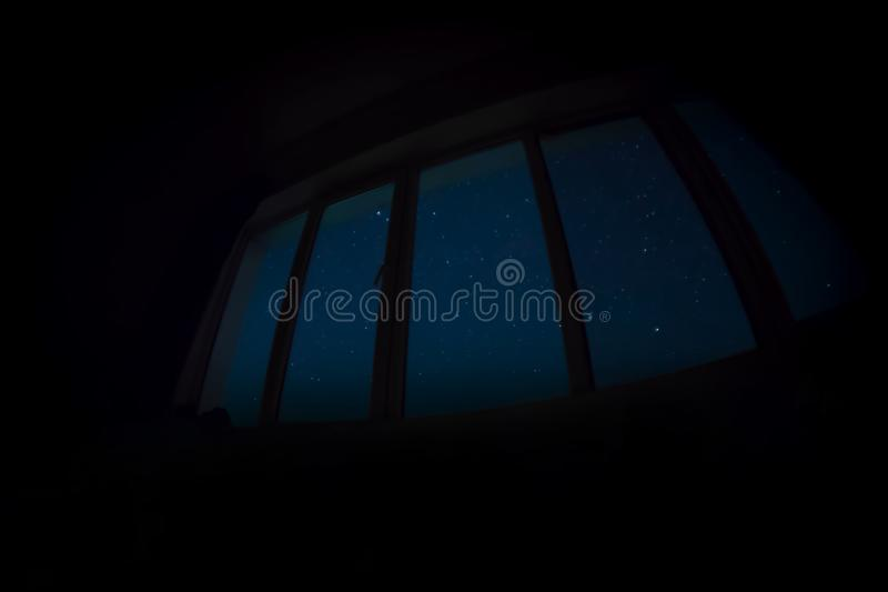 WIndow with view on night sky with stars. Dark room. WIndow with view on night sky with stars royalty free stock photography