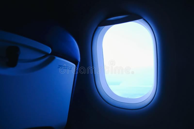 Window View From Passenger Seat On Commercial Airplane, The light of travel when looking at the plane window. stock photography