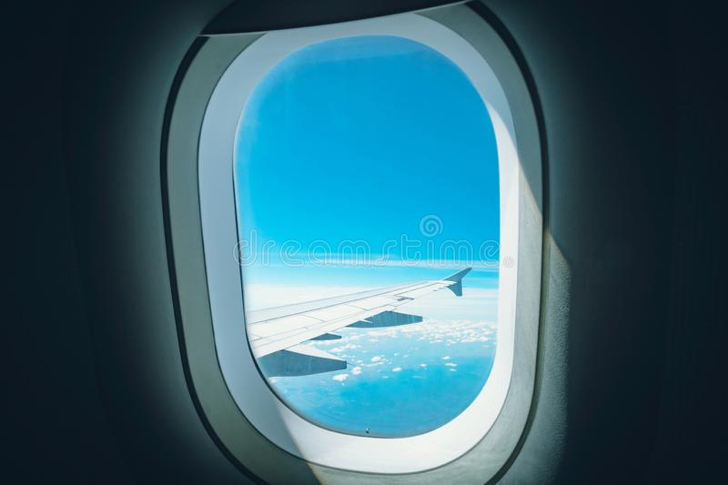 Window View From Passenger Seat On Commercial Airplane. wing of the aircraft can be seen in the window. Window View From Passenger Seat On Commercial Airplane royalty free stock photo