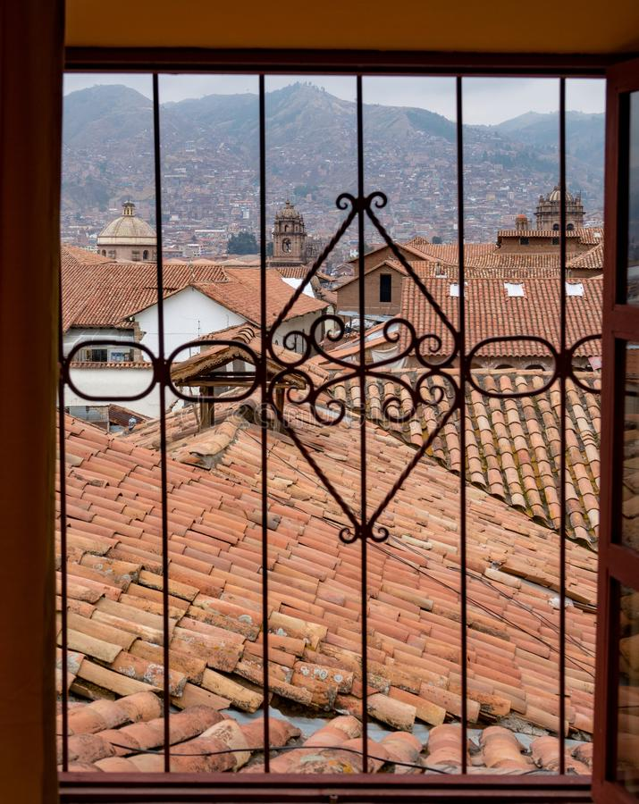 Window view to red roofs of Cusco Peru royalty free stock photos