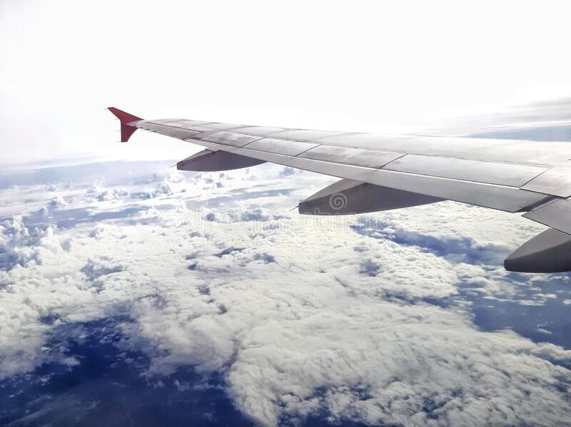 Window view of the wing of an airplane - image stock image