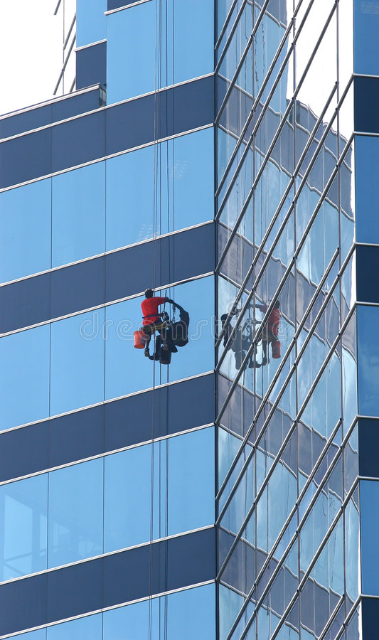 Free Window Washer On Blue Glass Stock Images - 2757024