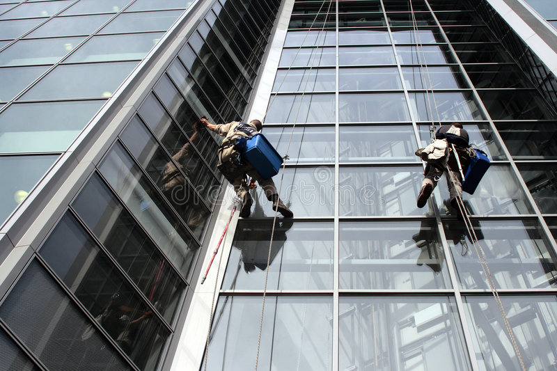 Window washers. On tall building royalty free stock images