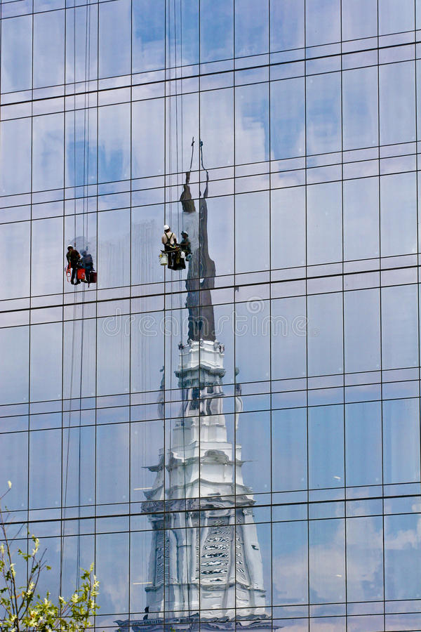 Free Window Washers On Glass With Church Reflection Royalty Free Stock Photo - 12265395