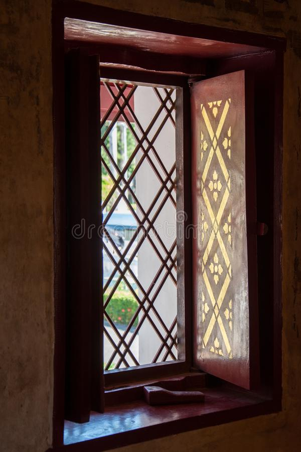 Window in Wat Phumin is a unique thai traditional Temple in Nan. Province ,Thailand royalty free stock image
