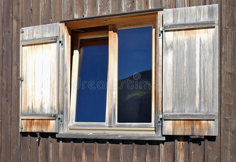 Window with weathered shutters royalty free stock photo