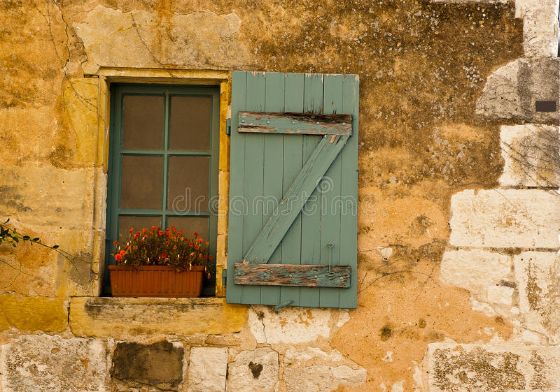 Window wood shutter flowers Monpazier stock images