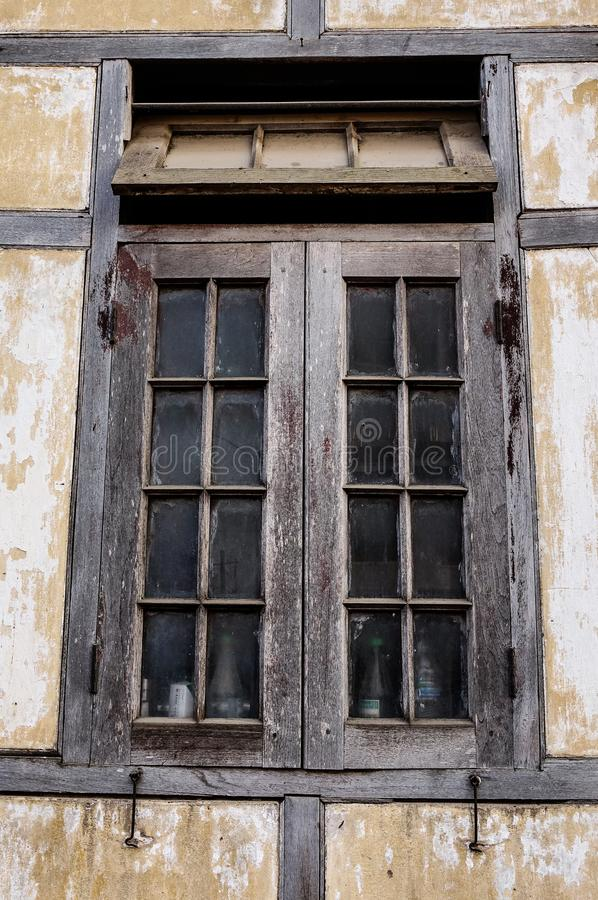 Window with the wooden carved architrave stock photos