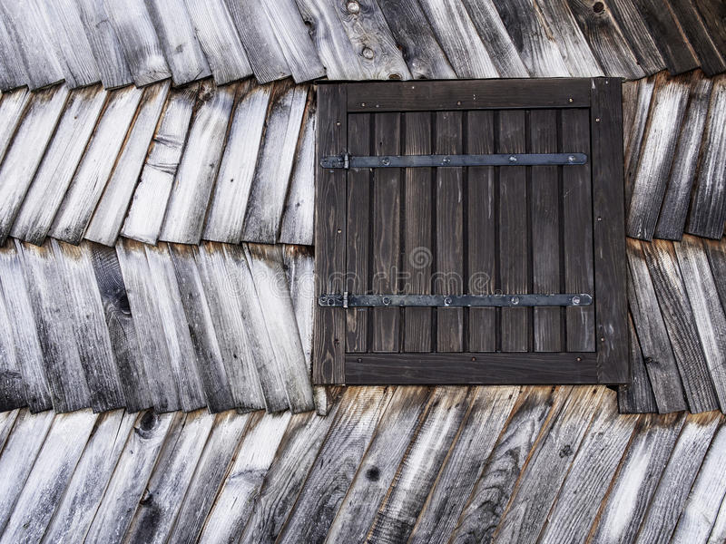 Window. In an wooden peasant house, ethnic house and royalty free stock image
