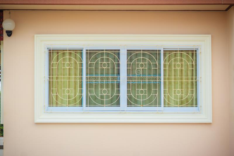Window with wrought iron to prevent theft. Newly built house wit stock photography